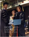 J. Clay Smith, Jr. presenting degrees to Anderson and individual unidentified students (1/10)