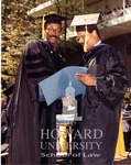 J. Clay Smith, Jr. presenting degrees to Anderson and individual unidentified students (4/10)