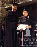 J. Clay Smith, Jr. presenting degrees to Anderson and individual unidentified students (7/10)