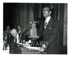 J. Clay Smith, Jr. giving speech  as president of the Federal Bar Association. William Hall stands right of Smith
