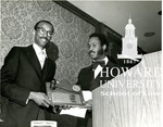 J. Clay Smith ike Leggett Esq presenting outstanding alumnus award to commissioner J. Clay Smtih Jr. on April 11, 1979 at the annual Howard Law alumni Diner