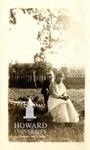 Ollie Mae Cooper and  Lark (?) in  Mrs. Davis's yard/pasonage, Allen Church, Garfield, (?)