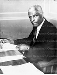 At His desk at Morehouse College
