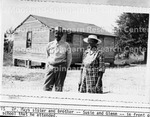 Dr. Mays's sister and brother: Susie and Glenn in front of the brick school the he attended
