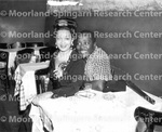 Unidentified man and woman pose for photograph