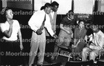 Unidentified group of Actors with woman surrounded by men