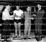 Weightlifting - Unidentified Weight Lifters Win Trophies