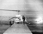 Helicopter - Unidentified Man in Driving Suit and Helicopter