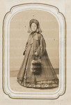 Unidentified young woman in fur hat, oversized coat, and carrying a fur bag