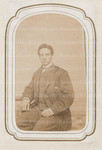 Unidentified male seated in suit and vest