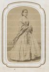 Unidentified woman posing in flannel dress