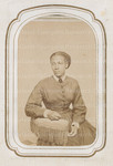 Unidentified young woman posing on chair