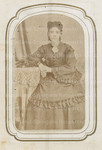 Unidentified woman posing while leaning on table