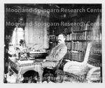 Moorland, Jesse seated at desk