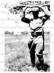 Thomas Montgomery Gregory holding rifle