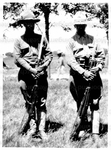 Unidentified Man and Thomas Montgomery Gregory posing with rifles