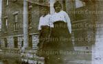 2 black women standing